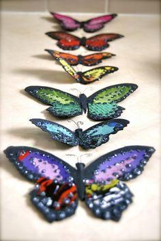 paper scrap and glitter butterflies by Davona Douglass
