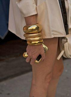 gold bracelets and a blackberry to match!