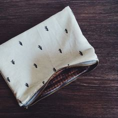 hand printed zipper pouch with vintage wool lining, trees and arrows mi+ed design