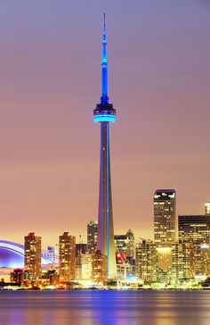 This is a picture of the amazing city of Toronto. I was born in Downtown, Toronto, Ontario. This picture shows the CN tower and the city around it however it is a landmark to show Toronto and I was not just born next to the CN tower of course. Torre Cn, Places To Travel, Places To See, Travel Destinations, Places Around The World, Around The Worlds, Visit Toronto, Toronto Travel, Toronto Ontario Canada