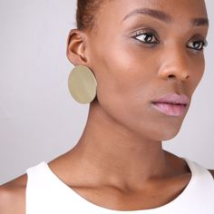 """Don't forget to add these statement fall studs to your must-have list! Hand-crafted with up-cycled brass sheet, these studs makes doing good while looking good a breeze.  Product Details   Material: Brass Sheet Width: 1.9"""" (50mm) Style #: FW1600020/S As this product is handmade, each is one of a kind and may vary slightly.    View Product Care Guide"""