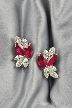 Platinum, Ruby, and Diamond Earclips, Aletto Bros., each set with two marquise-cut rubies, total wt. 7.84 cts., and marquise-cut diamonds, total wt. 4.55 cts., lg. 1 in., signed.