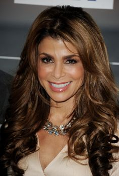 I really love Paula Abdul hairstyle.  I am leaning towards a cut like this.