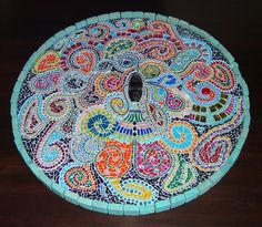 Majic. My latest mosaic work. Colored glass, beads, hand-painted glass on a wooden base. $333. Art by Nofi Barak.