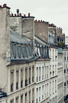 Parisian houses. - There's nothing like looking out over the Paris rooftops on a balmy evening, sipping a cocktail, and admiring views of the Eiffel Tower or Sacre Coeur. Explore Paris's Rooftop Bars: 10 Summer Hotspots at TheCultureTrip.com