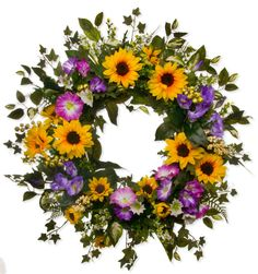 $169 SW 166 Designed from an all natural grape vine base Brenda decorates it with the finest silk floral available, including Orange/Yellow Sunflowers, purple hollyhocks, purple petunias, white status, fern, and greenery. More wreaths at http://www.darbycreektrading.com/Spring-Wreaths-C265.aspx