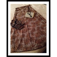 "LEOPARD MAXI Leopard print roll waist 95% polyester & 5% spandex maxi skirt. Fits like a large. Waist 16"" laying flat & length 43"", NWOT fun item!! Skirts Maxi"