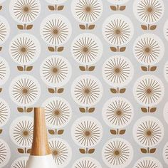 """Showcasing a delightful sunburst-inspired motif, this peel-and-stick wallpaper panel brings effortless style to any room. Make a bold statement on an accent wall, or let it add a patterned pop as a contemporary kitchen backsplash. Product: WallpaperConstruction Material: FabricColor: WhiteFeatures: Easy installation Peel and stick materialRemovable Sunburst-inspired motifDimensions: 24"""" x 12"""""""