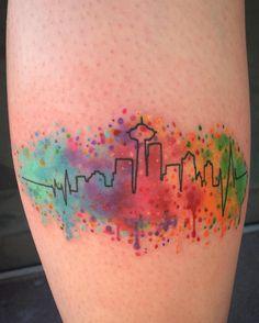 Color splattered Seattle skyline. #seattletattoo #watercolortattoo…
