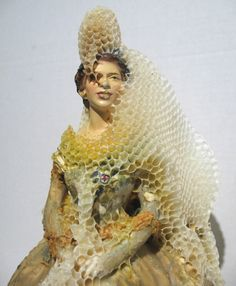 Aganetha Dyckis a sculptor, who initially worked with a range of sculptural media like wool, cigarettes and buttons. Since 1991 she has concentrated solely on collaborating with the honey bee as architect and places ordinary objects in apiary hives allowing the bees to create honeycomb to encrust the objects.