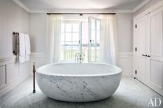 Vince Camuto's Long Island master bathroom features a custom-made marble tub with Waterworks fittings.