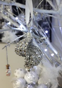 Seashell Christmas tree ornament DIY with rhinestone bling and small white pearls.