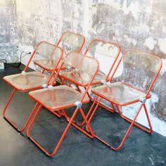 Located using retrostart.com > Red Plia Dinner Chair by Giancarlo Piretti for Castelli