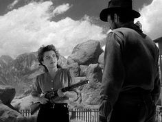 0 Anne Baxter with a rifle in  Yellow Sky gregory peck