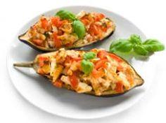 Berenjenas rellenas de jamón y parmesano. Información nutricional por porción 278 calorías 9 g proteínas 14 g grasa 29 g carbohidratos 12 mg colesterol 571 mg sodio