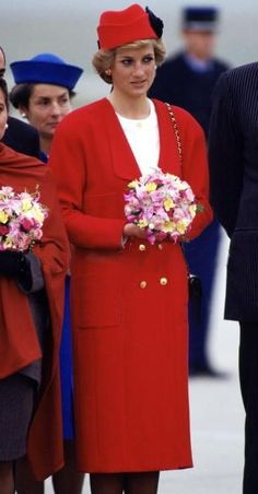 Princess Diana arriving in Paris wearing Chanel from head to toe as a way to pay tribute to her hosts. She wore a coat over a silk blouse & skirt with a jaunty hat with large decorative feathers also by Chanel.  November 7, 1988.