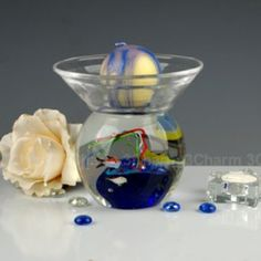 Size: 12.3DX14.3cm     Material: Murano glass     Description:  All of our glass crafts are true hand blown. They are different from the other glass crafts which are made by machine. Our glass crafts are handicraft in its true sense. Our products are international certified, they are controled in the standard quality field. Now we have some stocks to sell,and the real products will look exactly the same as photos.