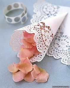 So Simple! Rolled up doily into a cone to hold flower petals for the flower girl to toss or as an alternative to rice/bubbles after the ceremony