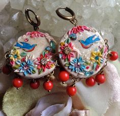 Lilygrace Ivory and Pastel Bird Floral Cameo Earrings with Coral Beads and Vintage Rhinestones by LilygraceOriginals on Etsy https://www.etsy.com/listing/79165791/lilygrace-ivory-and-pastel-bird-floral