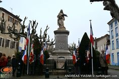 Leading up to Armistice Day in Crest, France. Monday November 10th - Students of Royannez school near the war memorial, read passages highlighting WW1 and made tributes to veterans. After a period of silence local dignitaries welcomed twinning committee members from Nidda (Germany) Crest (France) Cromer (UK) and Italy.
