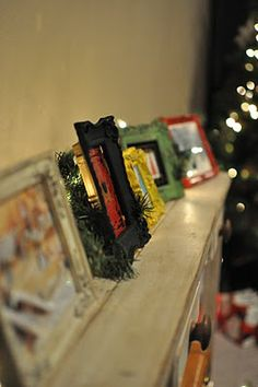 Buy thrift store frames, paint and add your favorite Christmas cards