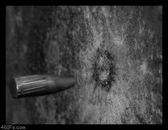 High speed camera gif of a bullet hitting a wall