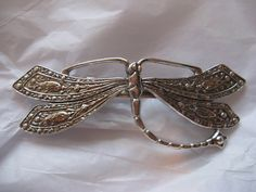 This lovely barrette sterling silver antique over silver casting.    Gorgeous detail in the vintage brass findings and attention to artistic