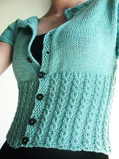 Peggy Sue by Linda Wilgus This pretty inspired cardigan is knitted from the top down with raglan shaping, with delicate cables at the cropped waist. Knit Vest Pattern, Sweater Knitting Patterns, Coat Patterns, Crochet Woman, Knit Crochet, Knitting Blogs, Summer Knitting, How To Purl Knit, Vintage Knitting