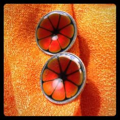 """Vintage Hogan Bolas Earrings - Orange Hogan Bolas was famous for treating their jewelry in layers. These look like orange flowers are trapped under water. So beautiful and catch the light spectacularly. .75"""" diameter Hogan Bolas Jewelry Earrings"""