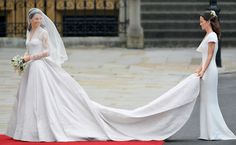 The future Duchess of Cambridge arrives at Westminster Abbey with her sister, Pippa Middleton, both in Sarah Burton for Alexander McQueen.