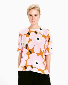 The A-line Pokkari shirt is made of viscose crepe and decorated with the fresh Unikko pattern in pink, orange and green. The shirt has a round neckline, a concealed zipper in the back seam and short kimono sleeves with elastic band gathers at the sleeve e Ikea Fabric, Short Kimono, Blouses For Women, Ladies Blouses, Marimekko, Knit Cardigan, Style Me, Ready To Wear, Lady