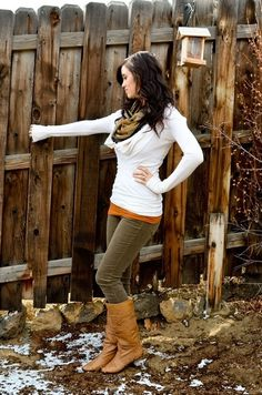 White sweater with brown pants and camel boots
