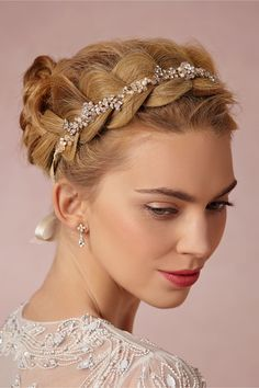I love this accessory adorned braid crown - perfect for a bohemian bride or so pretty for bridesmaids