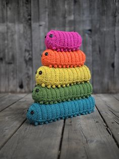 Army of Caterpillars pattern by Miranda Harp. I love it. I should collect all the bug crochet things I see and make a little Forest scene.