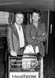 Phil Collins and Tony Banks of Genesis at Heathrow Airport after their American tour. 1986