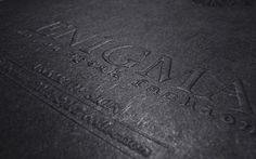Black on black hot stamping, accompanied by an embossed title treatment.