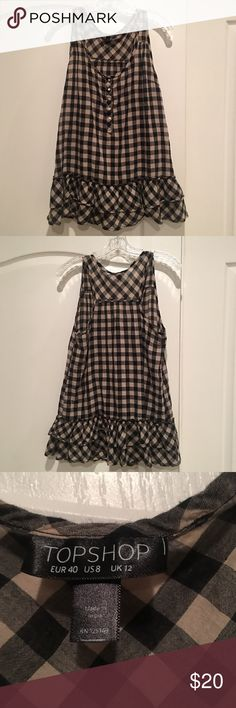 TopShop Checkered Plaid Peplum Top Purchased on Posh but unfortunately it didn't really fit me :( Super cute peplum style shirt. Topshop Tops