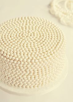Pearl Cake: 4-Layer Vanilla Bean cake with Vanilla Bean Swiss Meringue Buttercream.