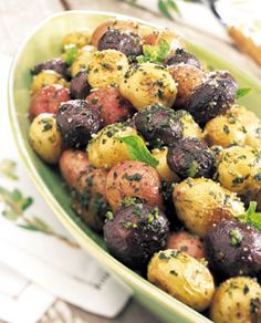 Tricolor Potatoes with Pesto and Parmesan ... I plan to sub in garlic scapes instead of garlic cloves in the pesto.