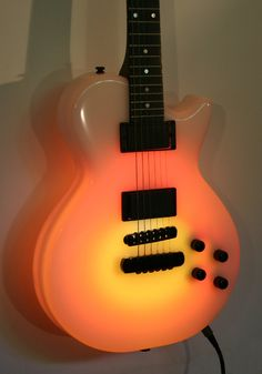 Tonal Musical Instruments   Rich Roland Custom NEON Lights Guitar in Orange with Brown and Yellow ... Rock a colorful tune!
