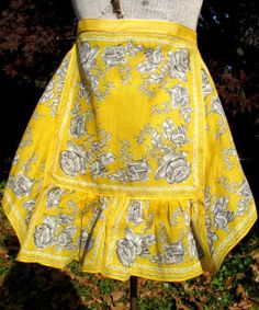 "Wonderful ""hanky apron"" with gray/white roses and a killer yellow background and the satin yellow ribbon waistband gives it a little pop of fancy!!!"