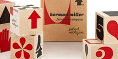 This miniature representation of the Eames-designed Herman Miller shipping boxes features alphabetic elements from our Eames Century Modern font collection. #packaging #design