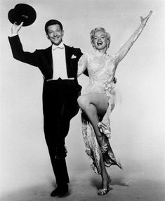 Donald O'Connor and Marilyn Monroe, shown in this 1954 file photo, step lively to an Irving Berlin tune in 'There's No Business Like Show Business.' Photo: AP / TWENTIETH CENTURY-FOX