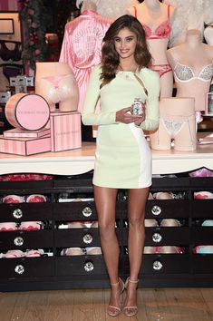 Taylor Hill went for a legs-for-days look in a super-short mint-green and white cutout dress by Mugler for a Victoria's Secret event.  Brand: Theirry Mugler
