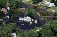 A trailer park south of Muscatine deals with high water, Thursday, July 3, 2014, as the Mississippi River moves toward the crest. (John Schultz, Quad-City Times)