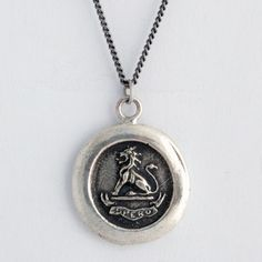 Lion is symbol of justice and wisdom  The seal reads Spero, which means Hope in Latin