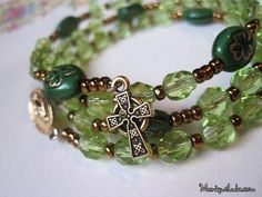 Green glass beaded Irish Catholic Rosary bracelet with shamrock and Celtic cross.