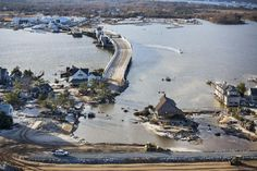 Mantoloking, N.J.: In the thin, oceanfront community of Mantoloking, seawater washed through the neighborhoods, wiping out houses and roads.