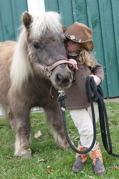 A miniature cowgirl with a miniature horse! Is there anything cuter?
