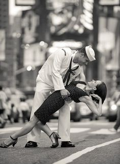 Love that they re-made that sailor kiss photo from WWII =D!!!!!!!